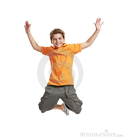 Excited little boy jumping in mid air on white