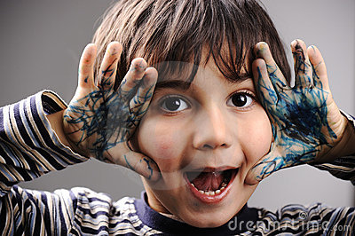 Excited little boy with messy color