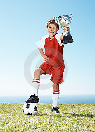 Excited little football champion