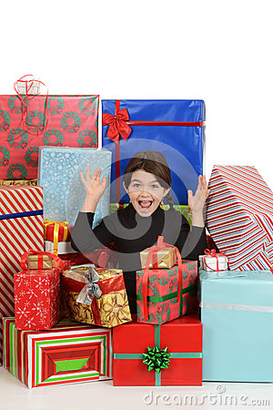 Excited little girl with christmas presents