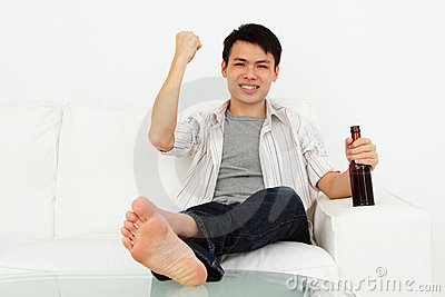 Excited man with beer