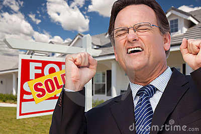 Excited Man in Front of Sold Real Estate Sign