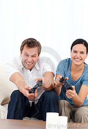 Excited man playing video games wth his girlfriend