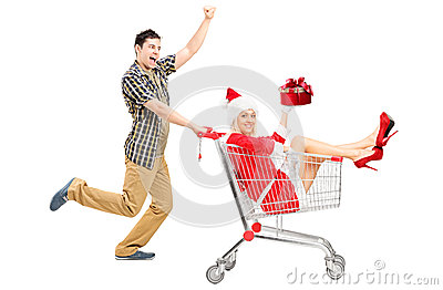 Excited man pushing a cart and woman