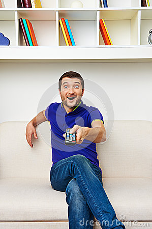 Excited man watching tv