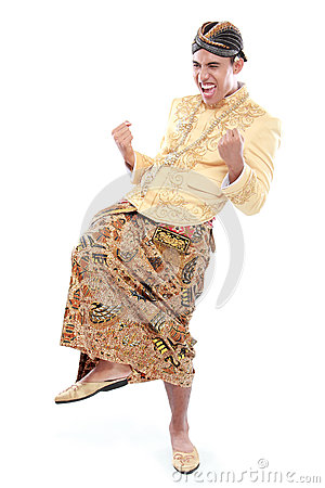 Excited man wearing traditional of java celebrating success