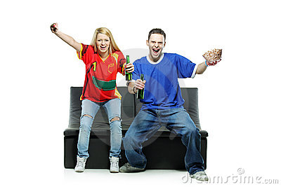 Excited man and woman watching sport