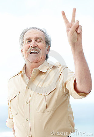 An excited mature man showing victory sign
