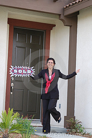 Excited Real Estate Agent In Front of Home - Sold!