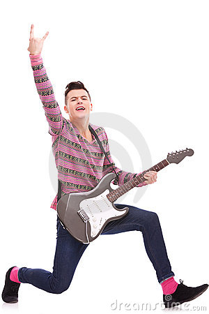 Excited rock star with an electric guitar