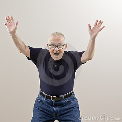 Excited senior man with arms raised