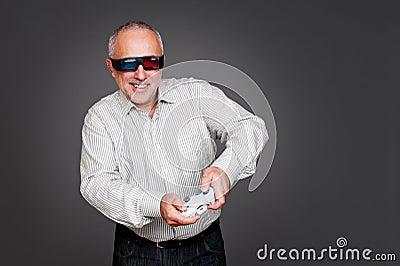 Excited senior man with joystick