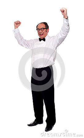 Excited senior man posing with raised arms