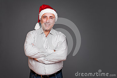 Excited senior man in santa claus hat
