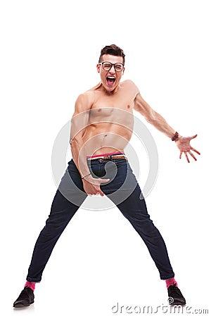 Excited shirtless man screaming