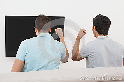 Excited soccer fans watching tv