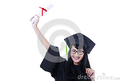 Excited student in graduation gown - isolated