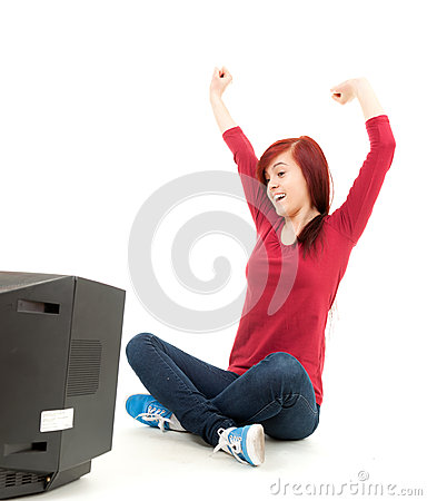 Excited teenage girl watching tv