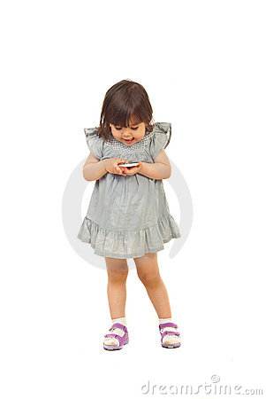 Excited toddler girl with phone mobile