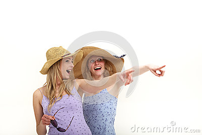 Excited tourists pointing while sightseeing