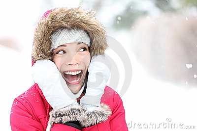 Excited winter woman looking to side