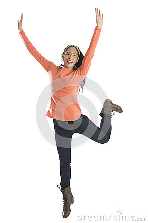 Excited Woman With Arms Raised Standing On One Leg