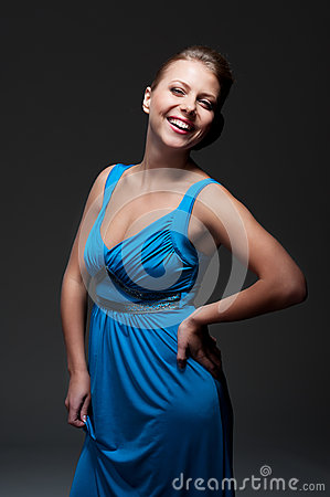 Excited woman in blue dress