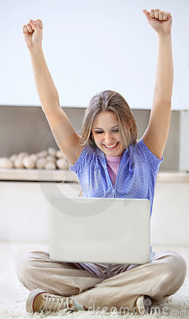 Excited woman with a computer