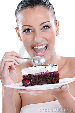 Excited woman eating tasty cakes