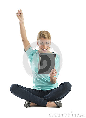 Excited Woman With Hand Raised Using Digital Tablet