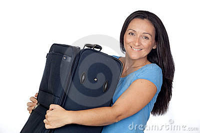 Excited woman with a heavy suitcase
