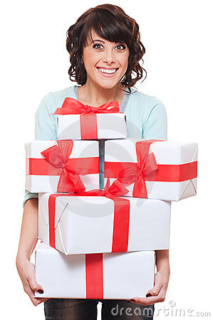 Excited woman holding gift boxes