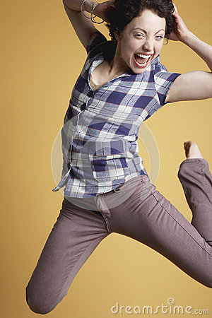 Excited Woman Jumping And Screaming