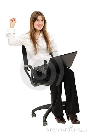 Excited woman with laptop  enjoying success
