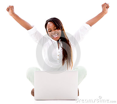 Excited woman with a laptop