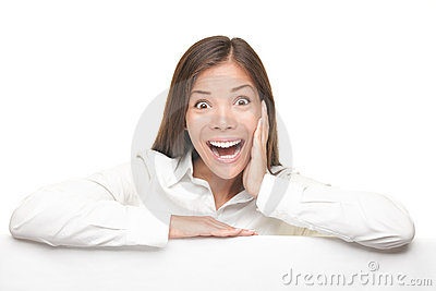 Excited woman leaning on empty white board