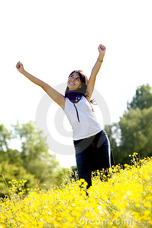 Excited woman in a meadow
