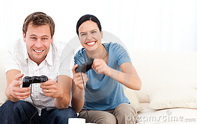 Excited woman playing video games