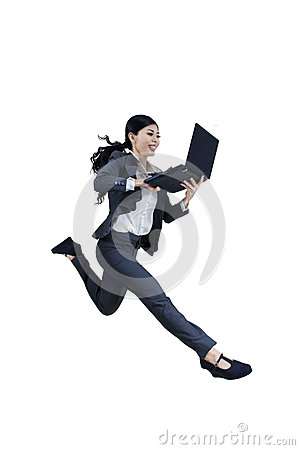 Excited woman running and holding laptop