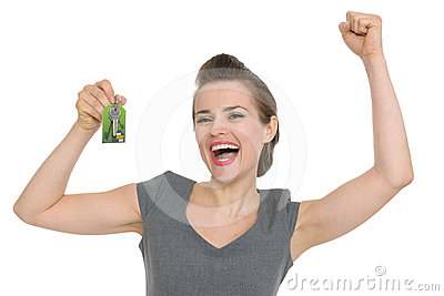 Excited woman showing home keys