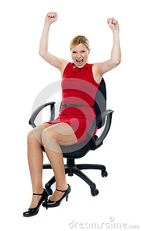 Excited woman sitting in chair. Isolated