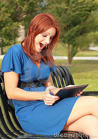 Excited woman with tablet