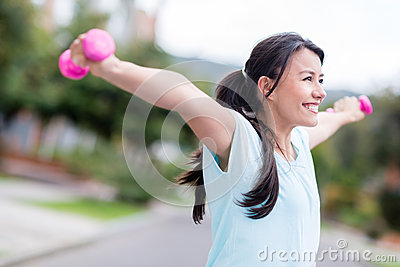 Excited woman training outdoors