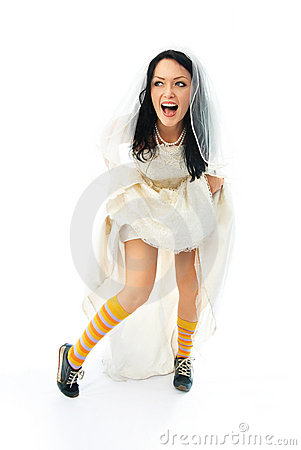 Excited young bride wearing sporting shoes