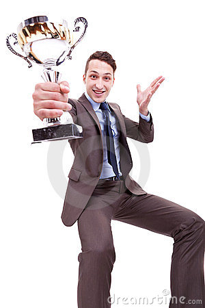 Excited young business man winning a nice trophy
