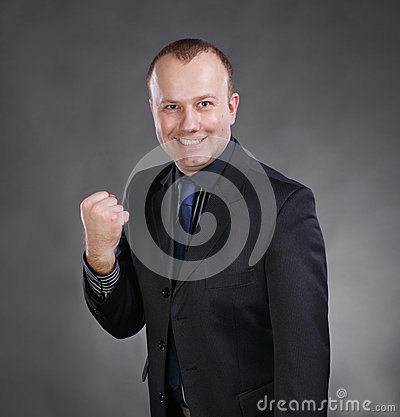 Excited young businessman celebrating victory