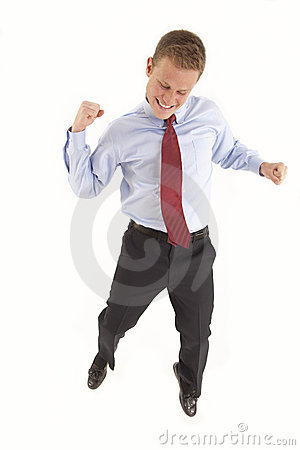 Excited young businessman jumping