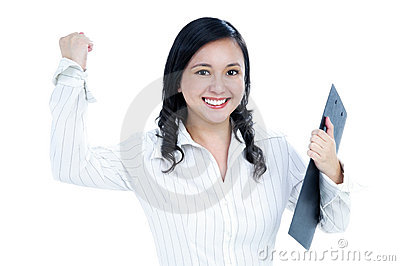 Excited young businesswoman clenching her fist