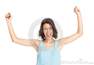 Excited young girl with her hands raised o