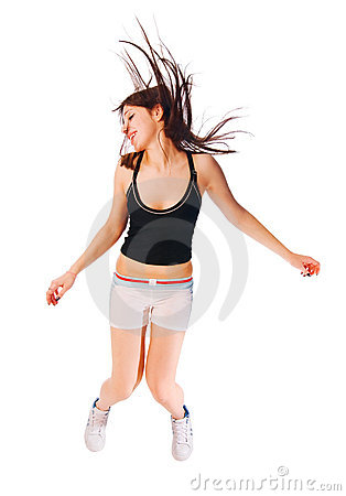 Excited young girl jumping on white